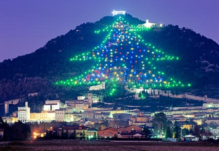 the worlds largest christmas tree display rises up the slopes of monte ingino outside of gubbio in italys umbria region composed of about 500 lights - Big Christmas Tree In New York