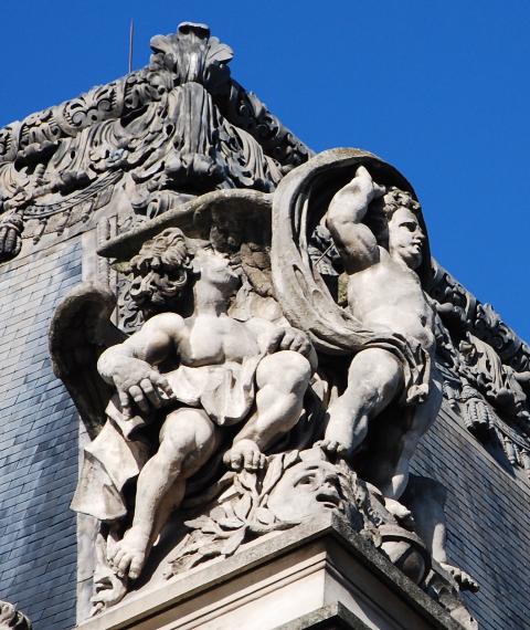 Louvre angel, left