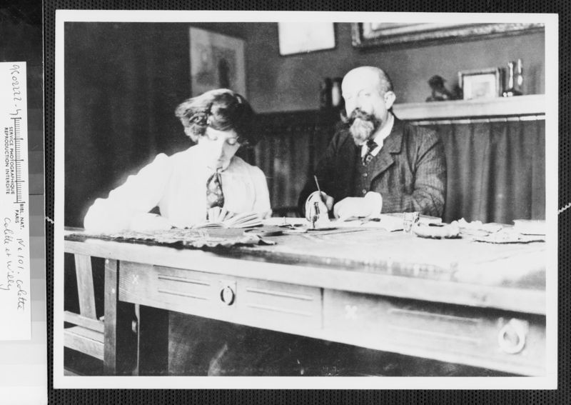 5. Colette and Willy at desk